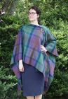 "Lambswool Tartan Serape. This beautiful piece is perfect for cooler evenings draped over a top or dress. Made by Lochcarron of Scotland.This item is made using cloth from their lambswool blankets. Dimensions are 70"" x 56"" and fringed at either end. Isle o"